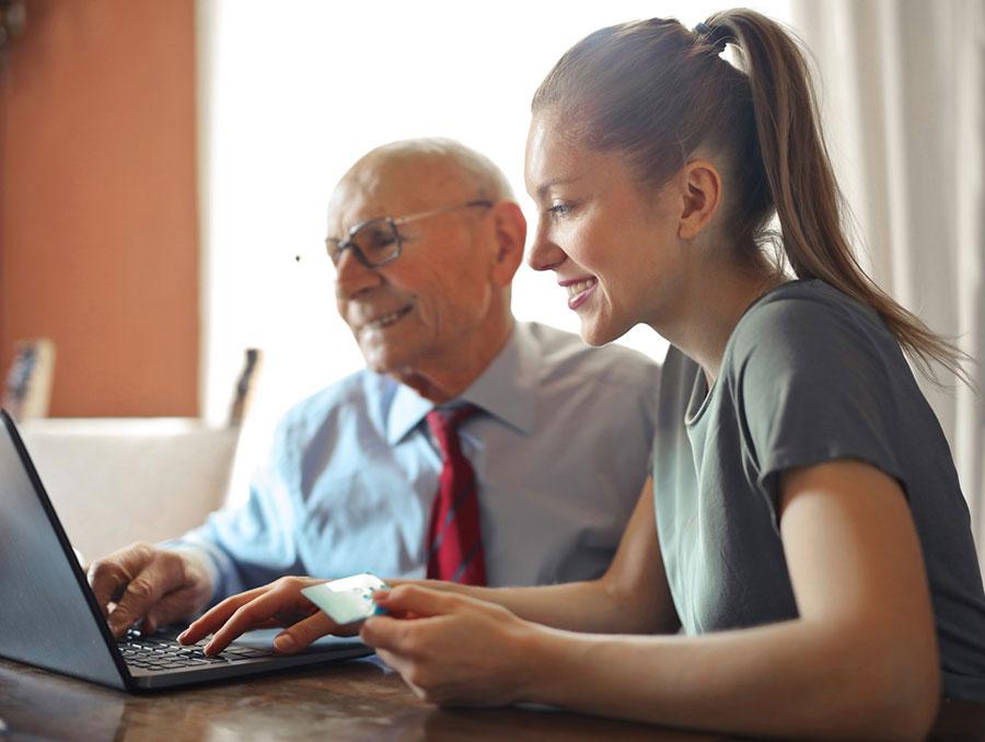 Woman and man looking at a computer