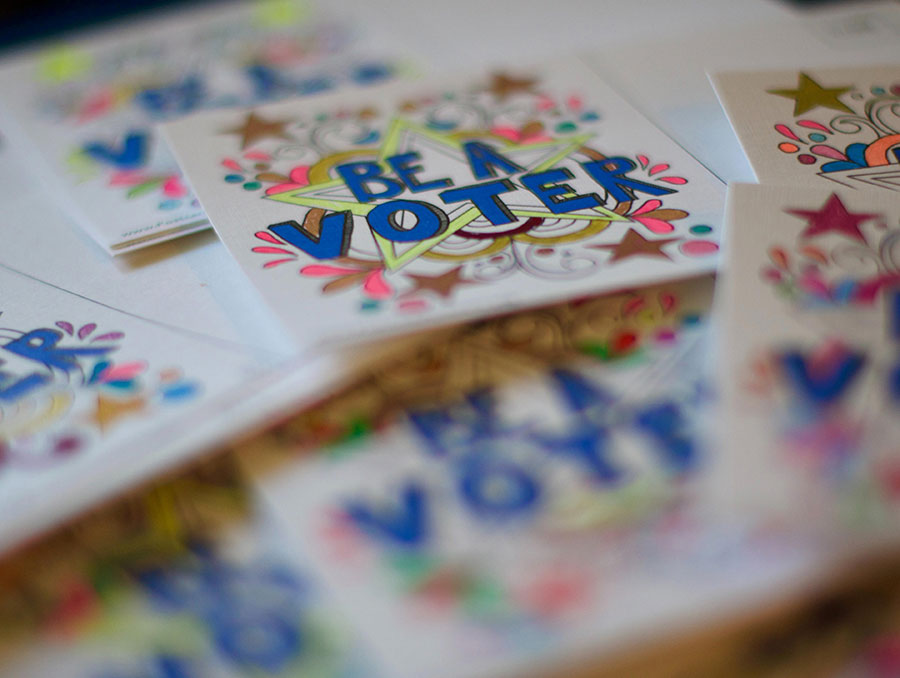Colorful sticker with the words 'Be a voter'