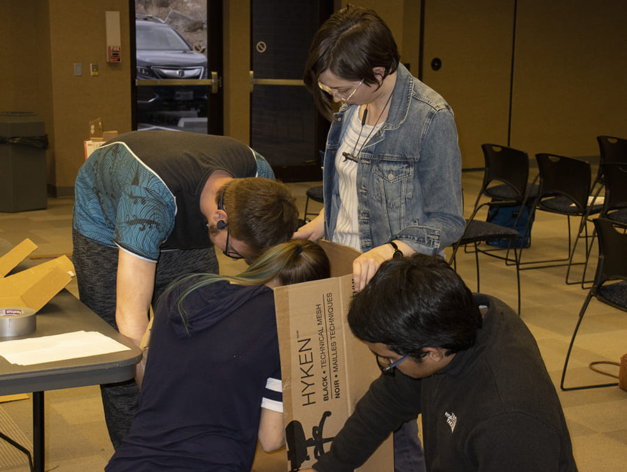 Students working on a cardboard box