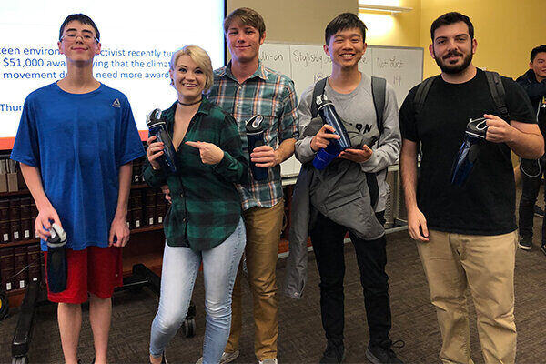 image of 5 students holding up their prize from the University Libraries' Trivia Night 2019.