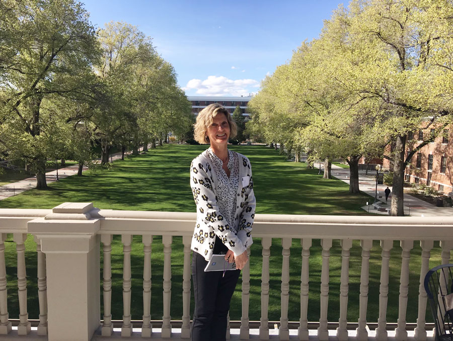 Amy Altick poses for a photo in front of the quad on the balcony of Morrill Hall.