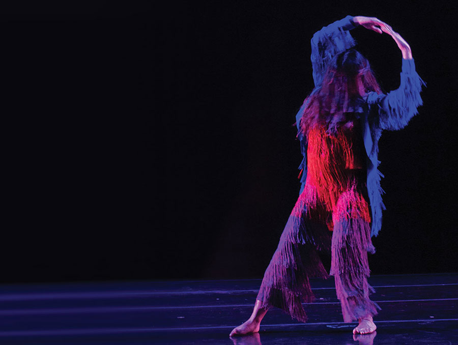 Dancer in fuzzy, hairy costume poses for dance performance