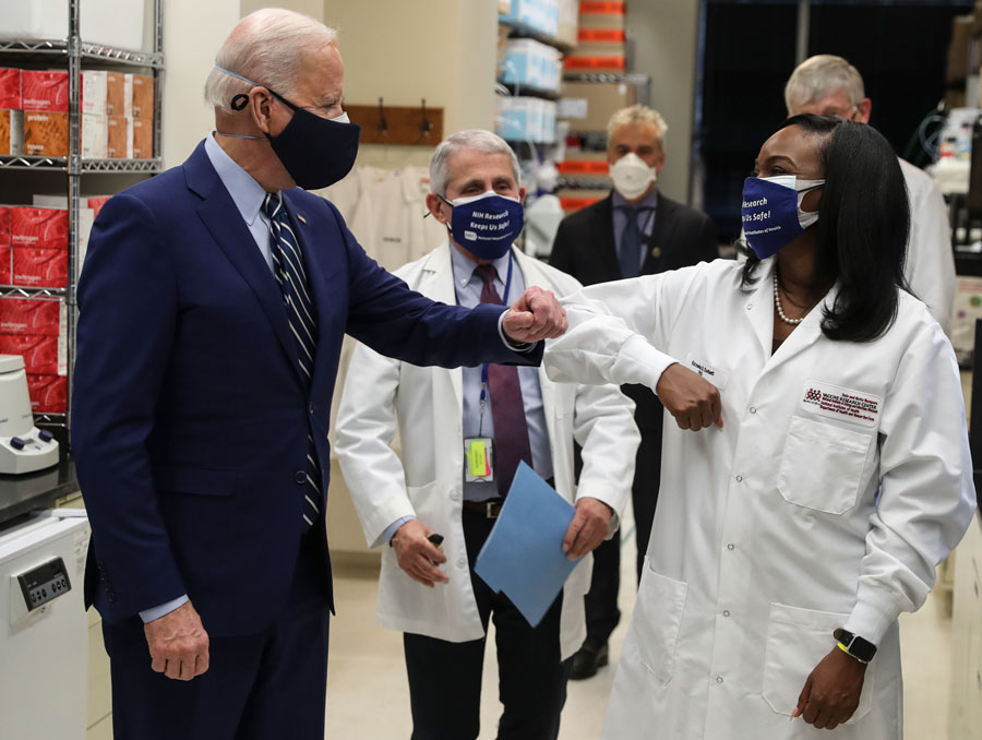 President Joe Biden greets Kizzmekia Corbett, an immunologist with the Vaccine Research Center at the National Institutes of Health during a visit at the Viral Pathogenesis Laboratory at the National Institutes of Health on Thursday, February 11, 2021 in Bethesda, Maryland.