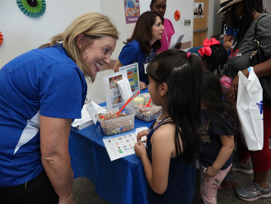 A young girl enjoys a hands-on learning activity at a previous Kickoff to Kindergarten event.