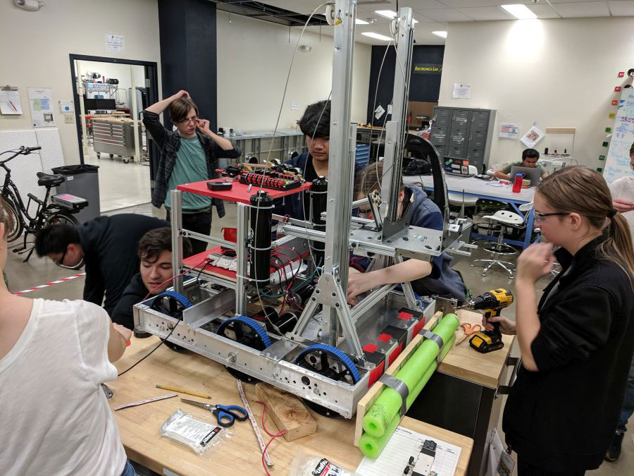 The FYRE Robotics team of high students builds a robot in the Makerspace of the Innevation Center.