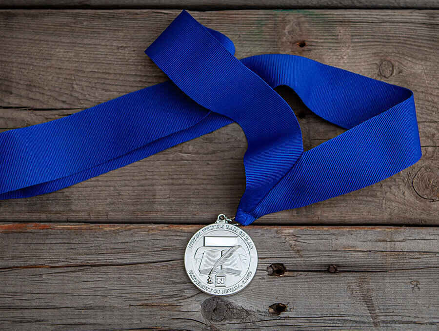 A silver medal with a blue ribbon
