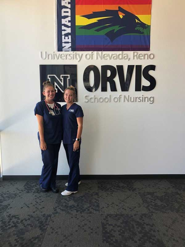 Haley Carroll and another nursing student at the entrance to the Orvis School of Nursing
