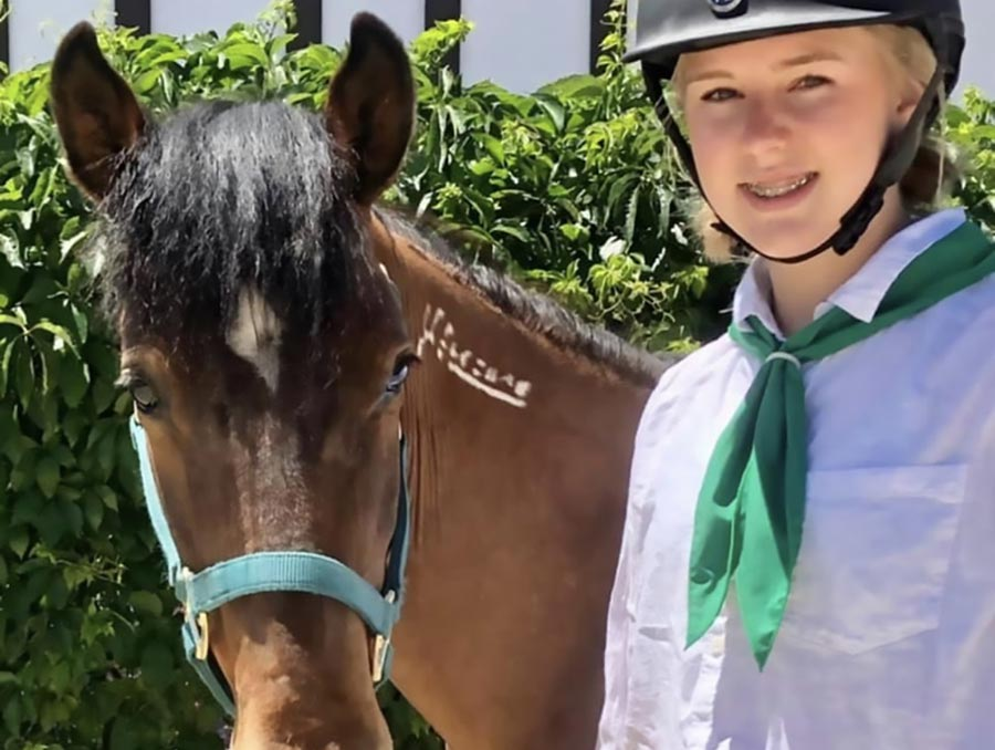 4-H youth Alexis with her horse Vinnie.