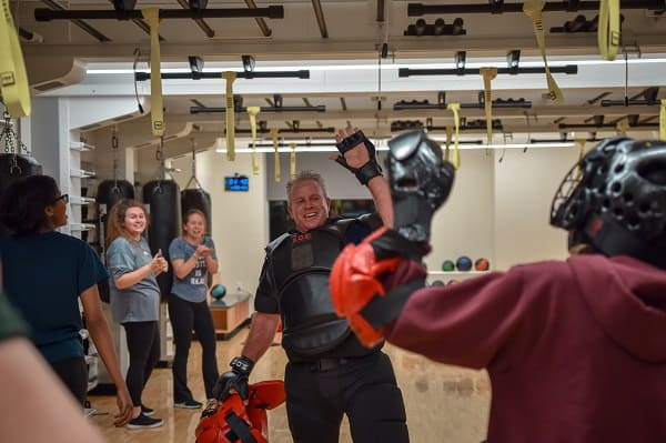 """University Police Commander Eric James instructs the """"Girl on guard"""" Self-defense course in the EL Wiegand Fitness Center."""