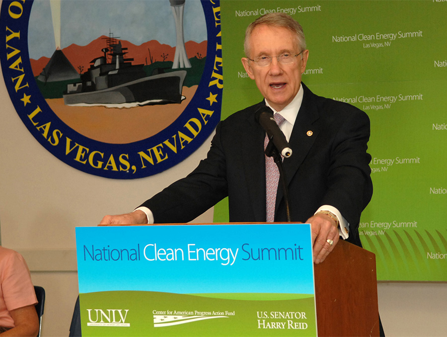 Photograph of Harry Reid present behind a podium at the National Clean Energy Summit