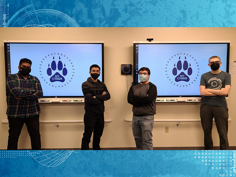 students wearing masks in front of television screens with Nevada Cyber Club logos