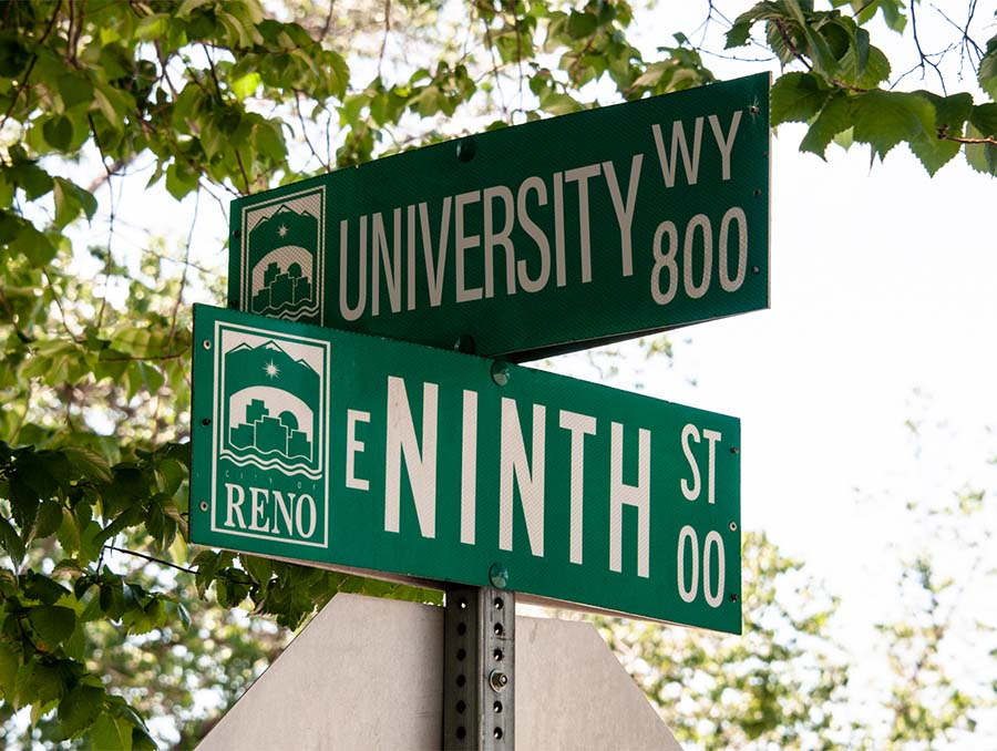 Street signs that read University Way and Ninth Street