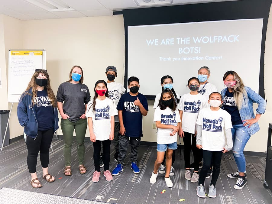 Wolf Pack Bots team pose for photo.