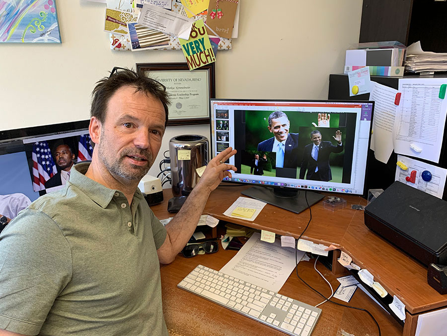 Markus Kemmelmeier points out examples on his computer of image samples used in his research study that address how the same photograph published in multiple newspapers portray skin tone differently.