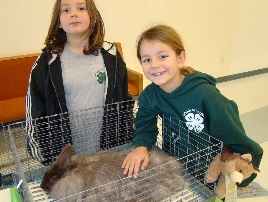 Two 4-H girls with their rabbit.
