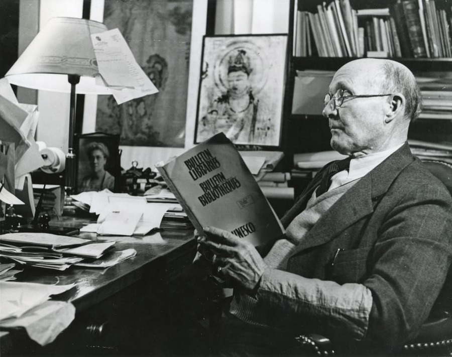 James Church sits at his desk in his campus office.