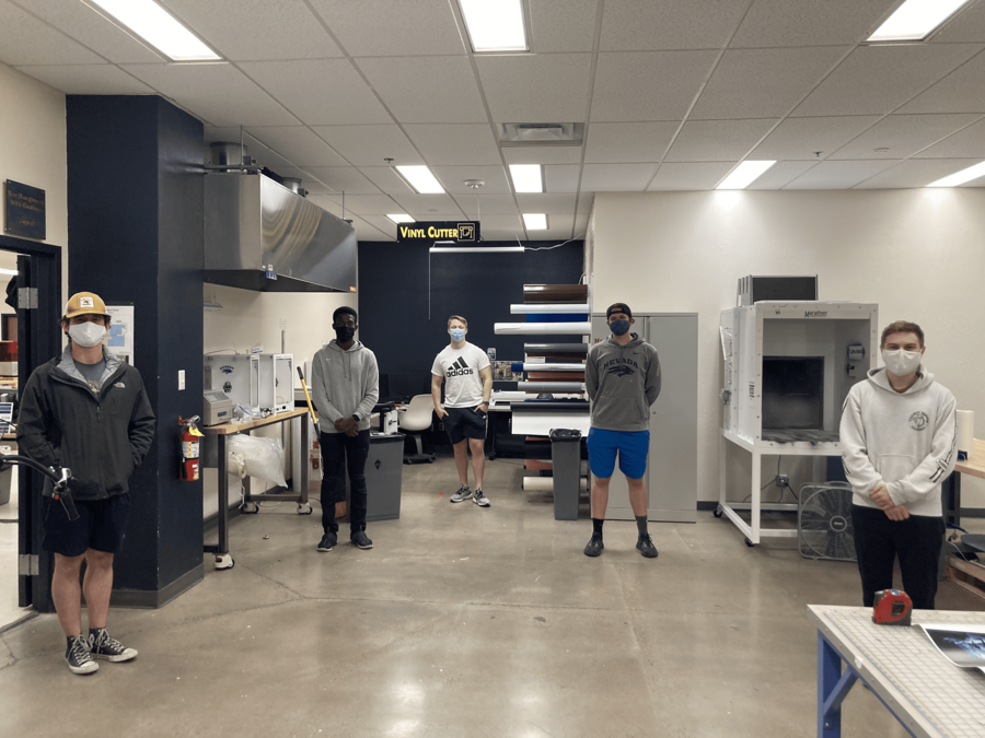 Five University students stand in the Makerspace.