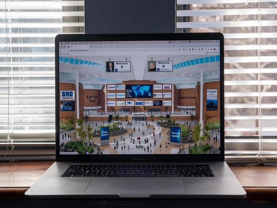 The International Women's Entrepreneurship Symposium's virtual conference platform displayed on a MacBook computer.
