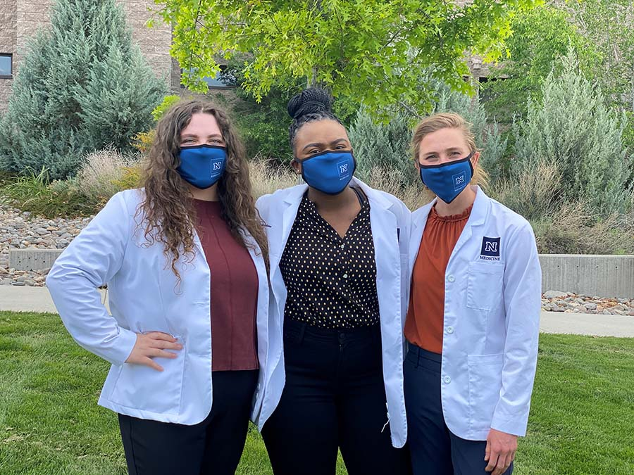 From left to right, University of Nevada, Reno School of Medicine students Haley Nadone, Mirabel Dafinone and Audrey Adler.