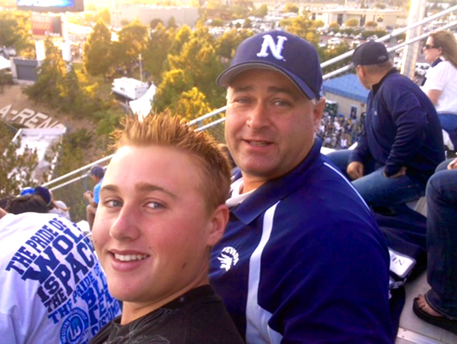 Chris and Dave crowther at a football game