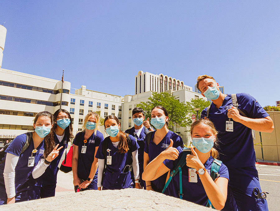 A group of Orvis School of Nursing students in their scrubs standing inside a hospital during clinicals