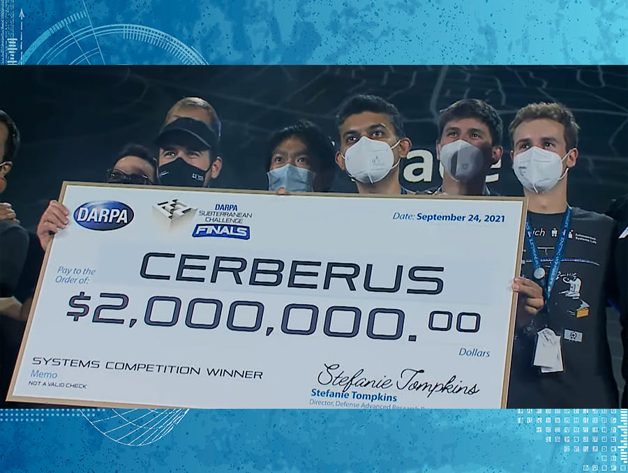 Check presentation with two million dollar check and research team