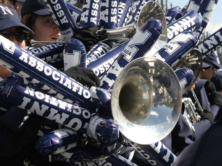 A trumpet surrounded by University of Nevada, Reno-themed noisemakers at homecoming