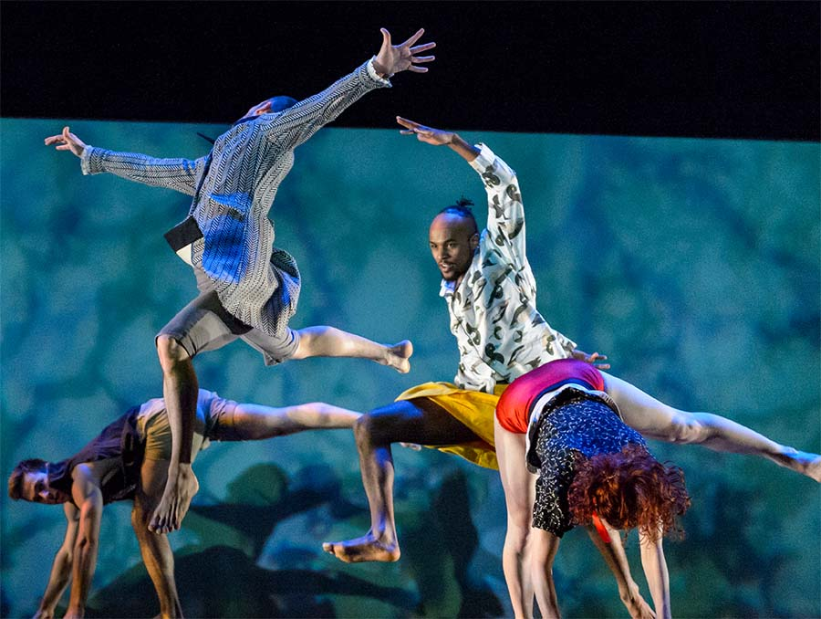 Performers of the Ririe-Woodbury Dance Company, Utah's most established contemporary dance company, dances on a stage.