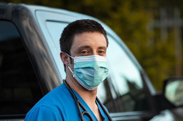 Dr. Sam Dugan looking tired after a day on shift during the coronavirus pandemic