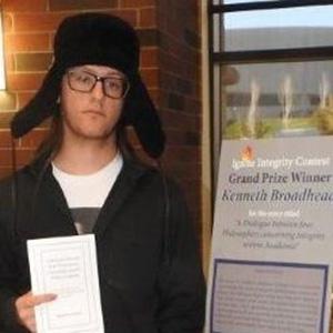 Kenneth Broadhead posing with his winning essay