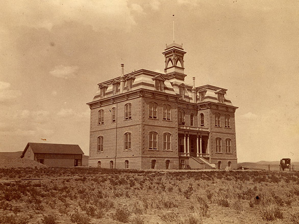 Image from 1898 of Morrill Hall with a smaller, now removed shed in the distance