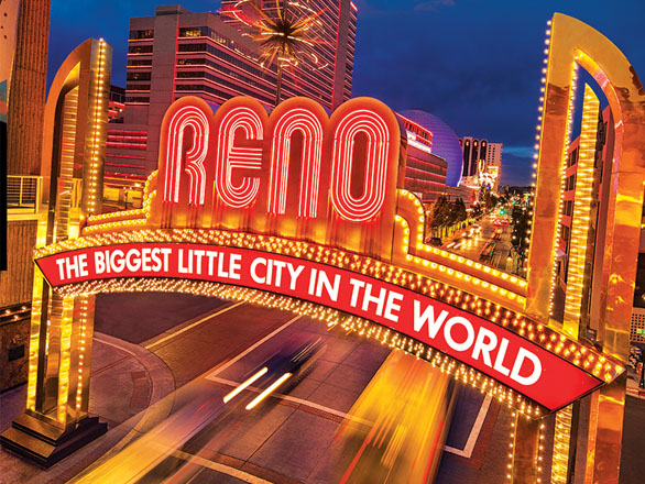 Image of the neon Reno sign on the downtown Reno arch in the evening